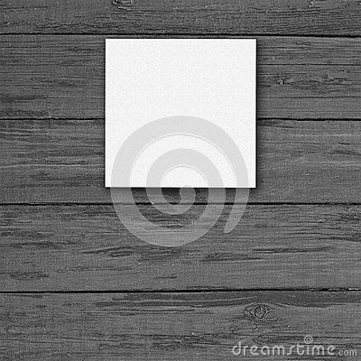 White canvas frame on a wooden background.