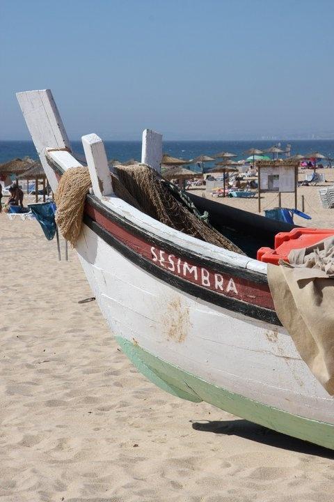 Sesimbra beach and its fishing boats.