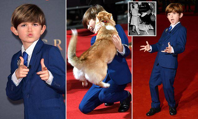 The excitable budding actor, 10, who plays Prince Charles in the Netflix drama, put his thumbs up at the cameras as he attended the world premiere in London's Leicester Square.