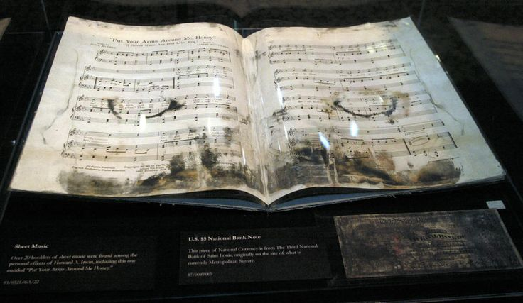 """A piece of sheet music for the piece """"Put Your Arms Around Me Honey"""", that was played by the doomed musicians aboard R.M.S. Titanic, after it was placed in the traveling Titanic exhibit Thursday, March 23, 2006. The piece of sheet music and a $ 5 bill issued in St. Louis in 1903 were both recovered from the bottom of the Atlantic. (AP Photo/Tom Gannam)Titanic Exhibitions, Beautiful Artifacts, Aboard R M S, Bill Issues, Musicians Aboard, Rms Titanic, Sheet Music, Doom Musicians, Music Book"""