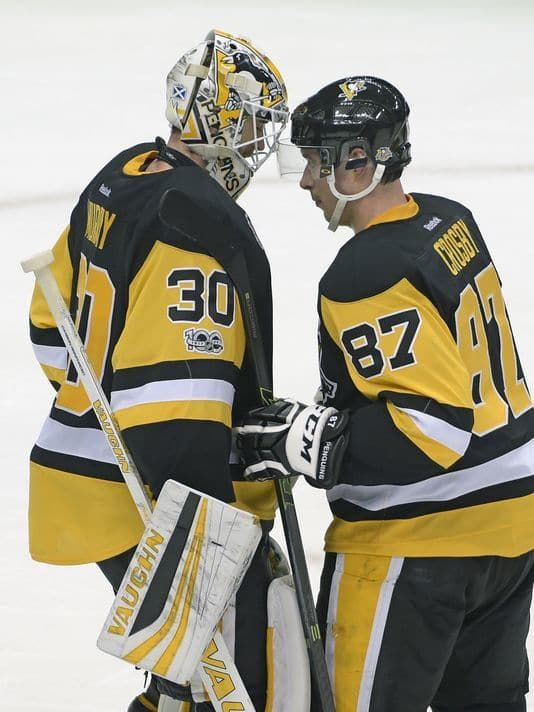 Pittsburgh Penguins goalie Matt Murray (30) is congratulated by center Sidney Crosby (87) after the team's NHL hockey game against the Nashville Predators on Tuesday, Jan. 31, 2017, in Pittsburgh. The Penguins defeated the Predators 4-2 and Murray picked up his 18th win of the season. (AP Photo/Fred Vuich)