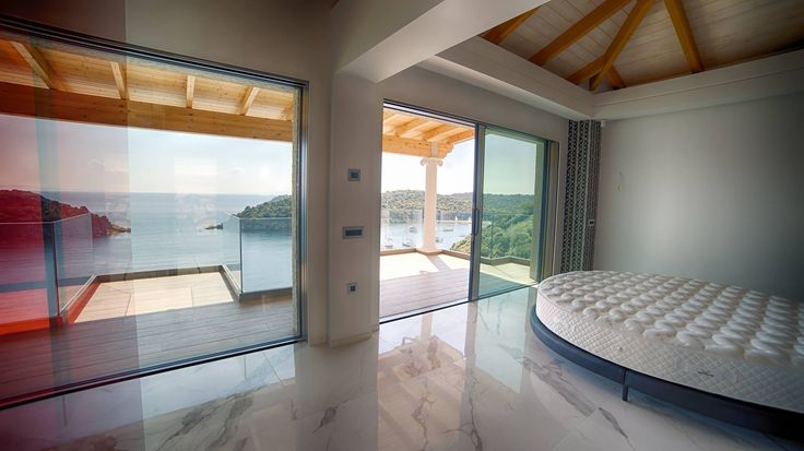 Villa Vrakas, four exclusive private homes equipped with Reynaers' ultra-slim Hi-Finity sliding doors. Location: Bella Vraka /Sivota /Greece Made by Simpas in 2016