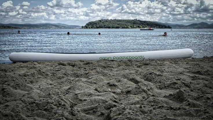 The side view of the Origin Paddleboards 10'0 Classic in front of Lake Trasimeno, Italy.