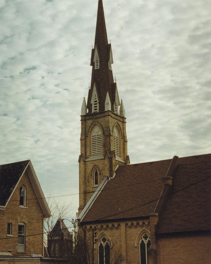 #throwbackthursday to downtown Oshawa in 1998.  Photograph of the roofs of two churches, St. Andrew's and Simcoe United.  St. Andrew's today is known as the Oshawa Community Church. The photographer named this photo 'Two Steeples.' From the Dowsley Collection (A016.10.122) #tbt #oshawa #ouroshawa #vintage #oshawamuseum #downtownoshawa
