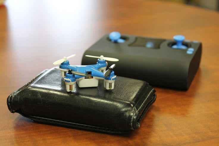 WALLET DRONE - World's Smallest Quadcopter. Tiny Quadcopter Docks and Charges INSIDE of a Wallet Sized Controller that Fits In Your Pocket!