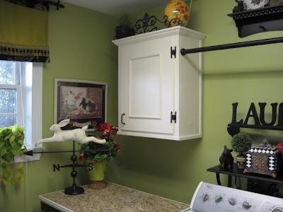 a happy green laundry room