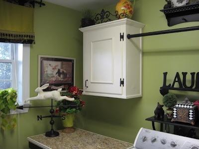 A Happy Green Laundry Room - Like the wall cabinet with curtain rod for hanging damp clothes.