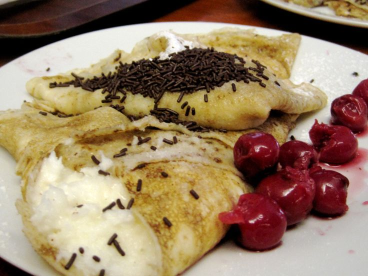 Hungarian Crepes filled with rice and cream, then sprinkled with chocolate sprinkles