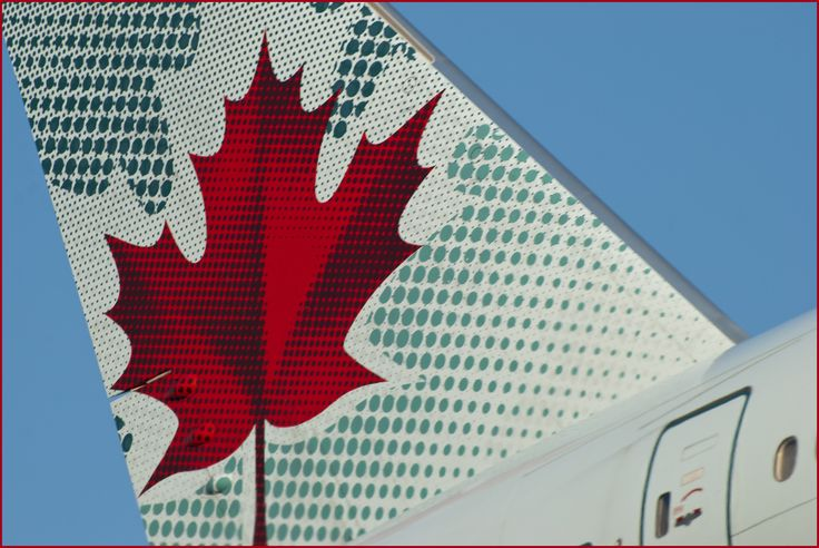 Tail Wing of Air Canada plane landing at Toronto Airport (YYZ)