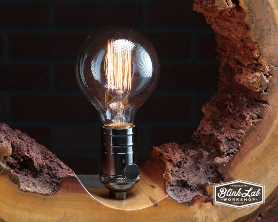 Crafted from a thick section of a hollow maple tree trunk. This lamp features a beautiful natural live edge. Perfect fit for a log cabin, rustic or eclectic decor. Metal black chrome socket with vintage globe bulb included. Measurements: Height: 16 Width: 17 Depth: 3-3/4  Check out all my handmade lighting here: https://www.etsy.com/your/shops/BlinkLab/tools/listings/section:10456257  Follow me on Facebook to see what I am working on next: www.Facebook.com/BlinkLabWorkshop