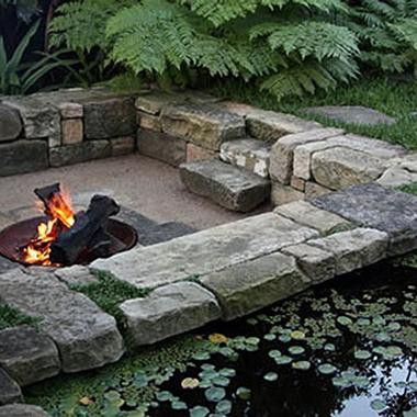 fire pit and sunken area by Spirit Level, Australia. Love this stonework