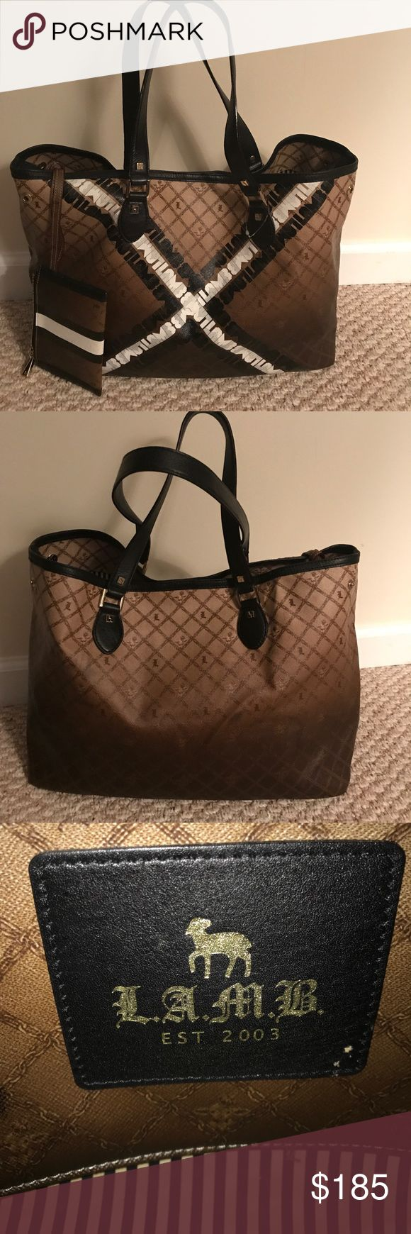 Beautiful authentic LAMB never full tote This is such a beautiful large LAMB never full tote with wallet. The bag is brown, lack and white. The hardware on the tote is gold. This bag is quite large and will hold your laptop and more! LAMB Bags Totes