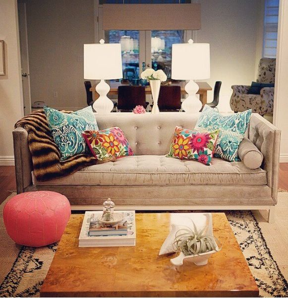 Colorful pillows to brighten a beige sofa.