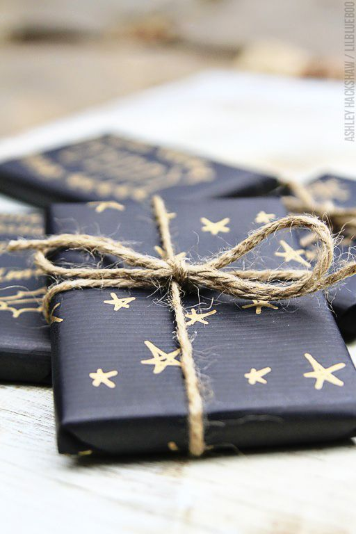 Use matte black wrapping paper and decorate with a gold pen. Some natural coloured twine is almost gold itself and completes this edgy and cool gift wrapping idea.