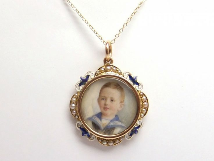 enamel and pearl gold open front locket