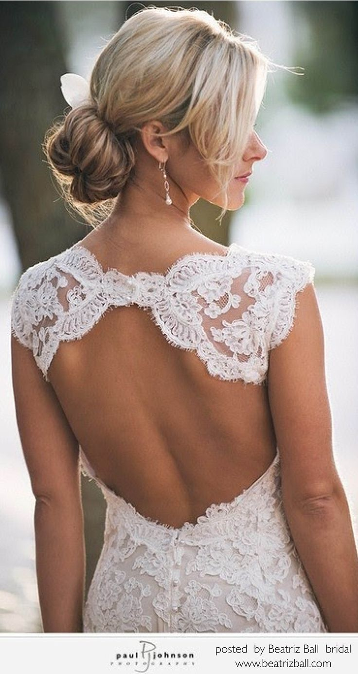 Lacy, vintage wedding dress. Stunning open back. Its sexy with elegant touches of seriousness.