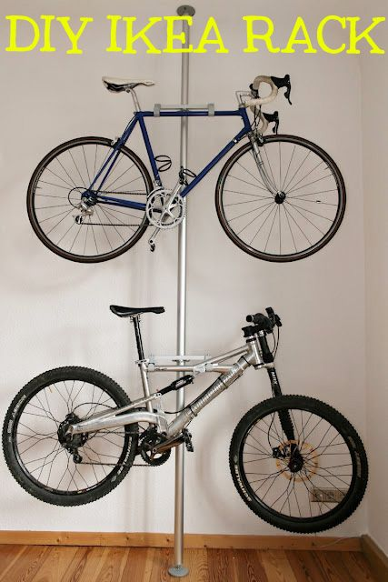 Here's a double bike rack made from a Stolmen post ($30), 2 brackets, and 4 hooks, all from IKEA. Click here for the full tutorial