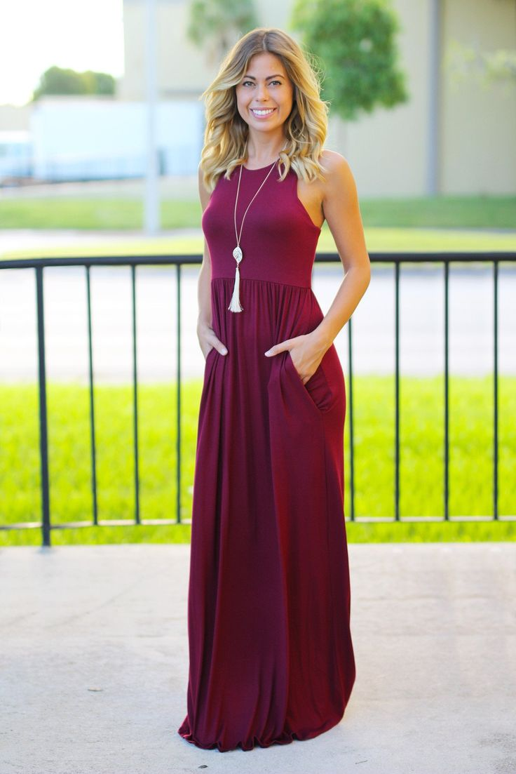 I love the neckline on this dress! Could pair a statement necklace with it to really dress it up for a wedding.  Also dress pockets are my favorite.