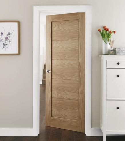 Single panelled modern door in light oak - maybe black matte door handles?