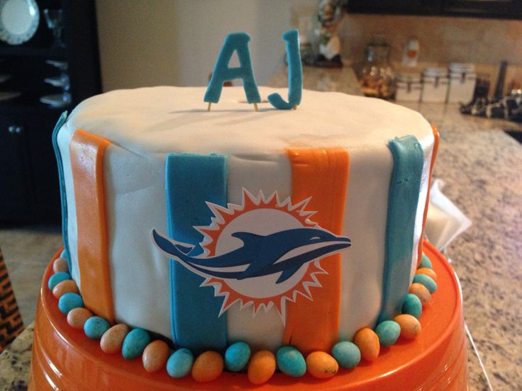 Miami Dolphins cake. Check out our Facebook page Ruzakos gift shop