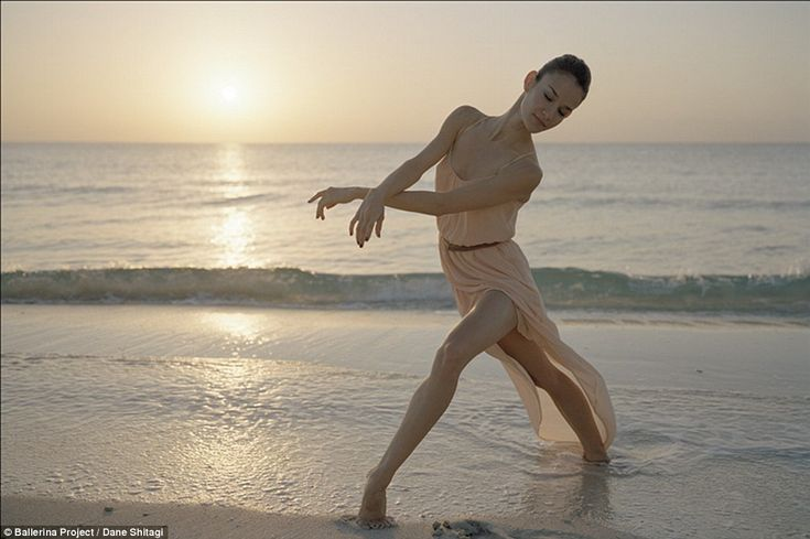 Helen Ruiz: The ballerina looks at one with the ocean in this twilight image taken in South Beach, Miami