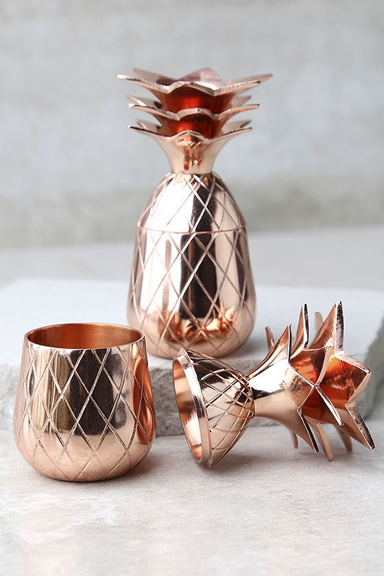 Impress your guests when you add The Pineapple Co. Copper Pineapple Shot Glass Set to your bar cart! This fun and funky set features two copper-plated pineapple shot glasses, with lids that double as cute stands!