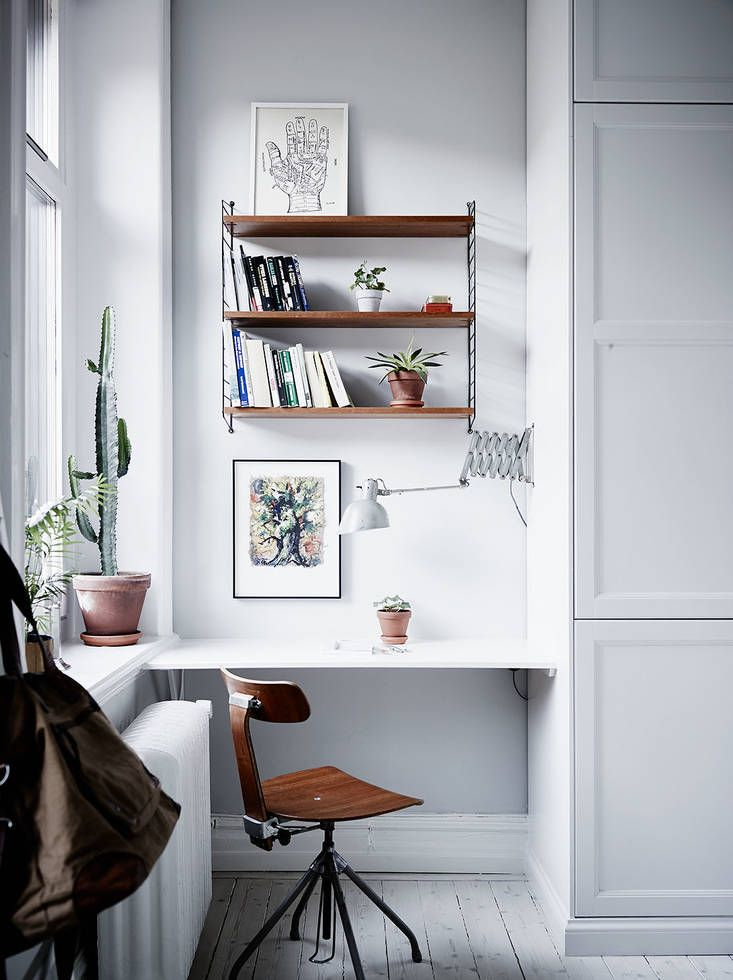 Home office with the greatest light. Smart use of an otherwise hard to decorate space in between window and wardrobe. Those vintage finds really gives the space that final, warm touch.