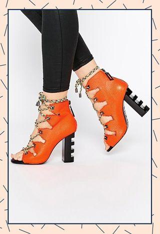 Kat Maconie orange lace-up ankle boots with cutout black heels
