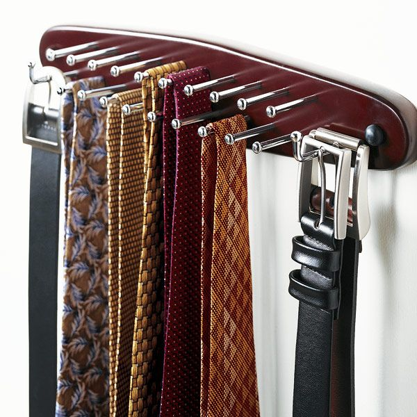 Crafted from Walnut stained Beechwood and outfitted with brilliant chrome hardware, our Tie & Belt Rack has 19 pegs for ties and two hooks for belts.