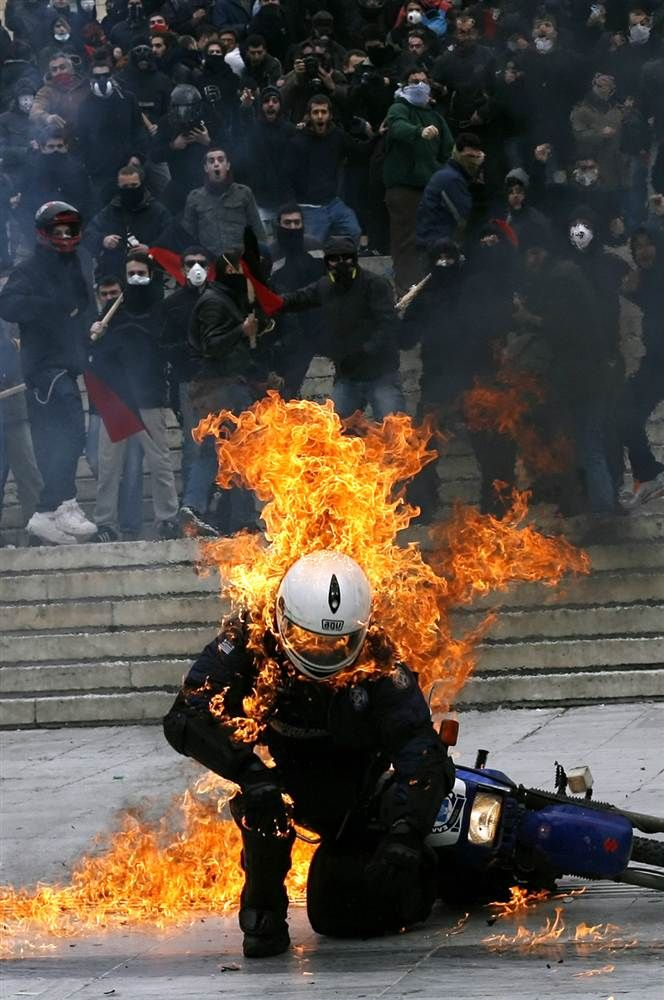 Flames of protest A policeman is in flames after a petrol bomb was thrown at him during riots in front of the parliament in Athens on Feb. 23. Protests against austerity measures flared in Greece as Prime Minister George Papandreou seeks to convince the cash-strapped country's eurozone partners to extend the repayment of a massive rescue loan.