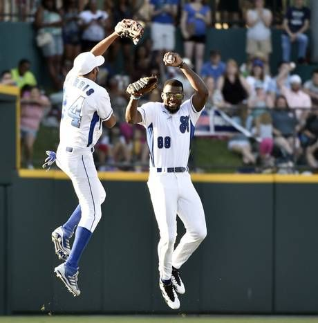 Devin Harris and Dez Bryant celebrate a Dez Bryant catch during the Dirk Nowitzki Heroes Celebrity Baseball Game at Dr. Pepper Ballpark in Frisco, Texas on Saturday, June 27, 2015. Michael Ainsworth/The Dallas Morning News)