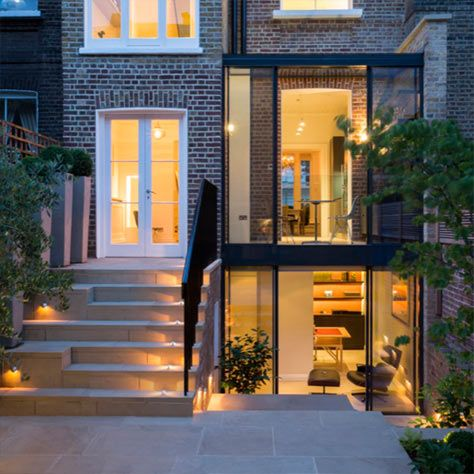 Double storey glass extension to Grade II* listed home in Kensington. All specialist glazing by IQ Glass