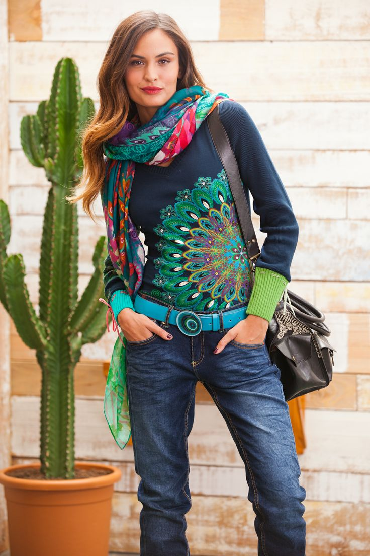 Desigual women's Danae T-shirt. This print has encrusted rhinestones and a really cool glitter finish. Ribbed cuffs and a velvet bow.