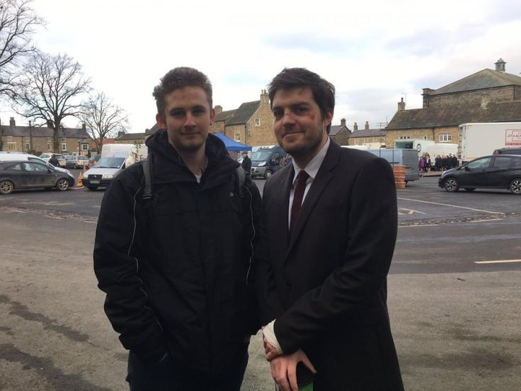 Tom_Burke_as_Cormoran_Strike_with_a_fan_Jk_Rowling_BBC