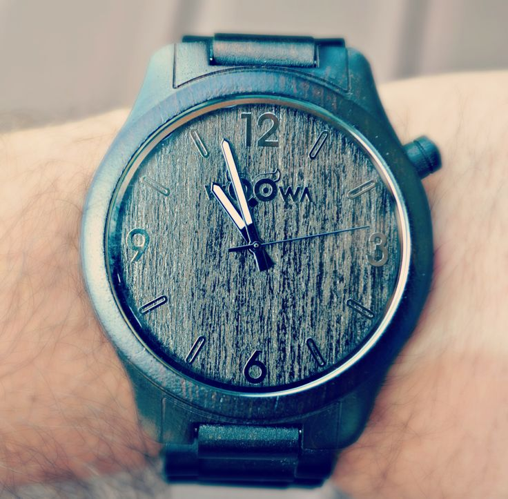 Real picture of wooden watch on hand.