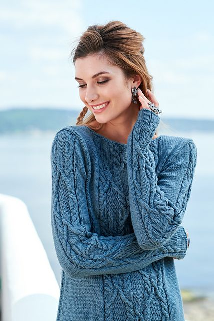 """A central cable that ends in a bulb captivated me into designing this long a-line sweater with vents in the side along the bottom rib. A few garter stitches in the side makes the seam look like a zip. The sweater ends in an I-cord bind-off at the neck only shaped by the shoulders. It is named Ronette which means """"strong councel"""" in Old English, because the cable pattern did just that."""