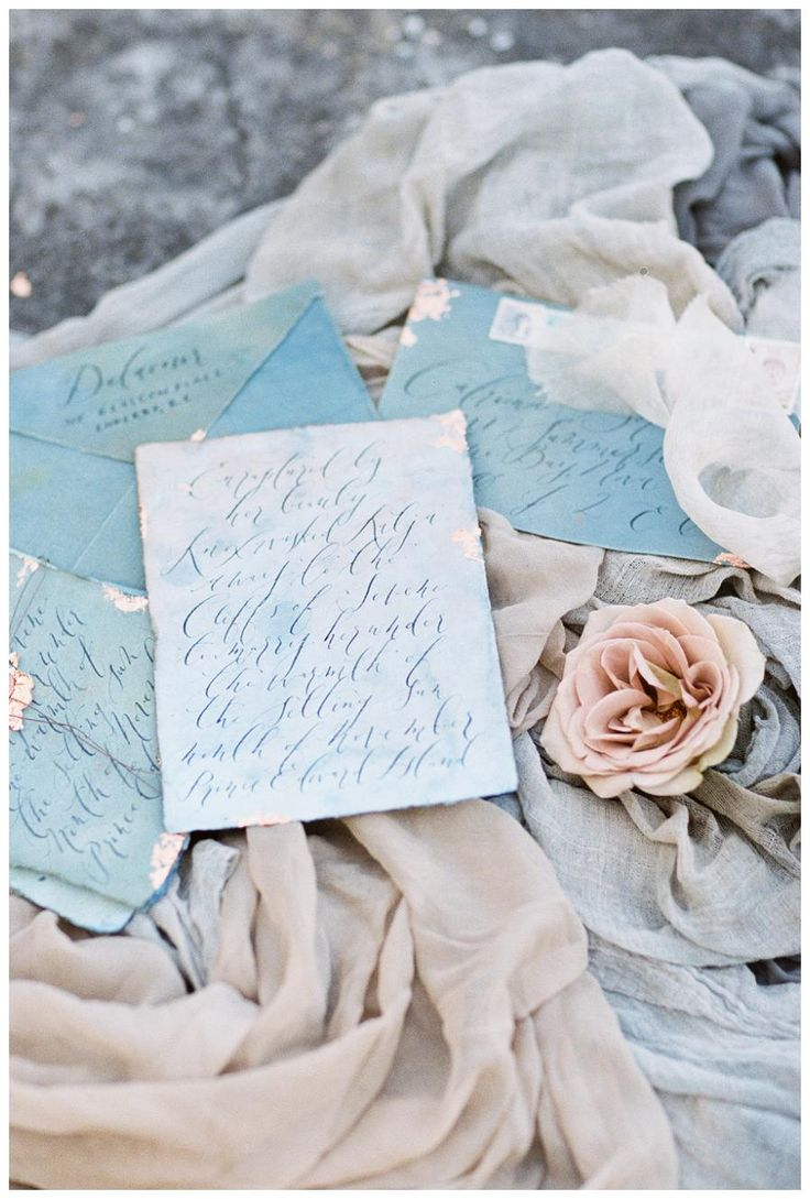 Pale blue wedding invitation suite on watercolor paper with graceful modern calligraphy and a rose gold wax seal. Invitation suite and calligraphy by Linen & Leaf, silk fabric by Silk & Willow. Image by Sleepy Fox Photography.