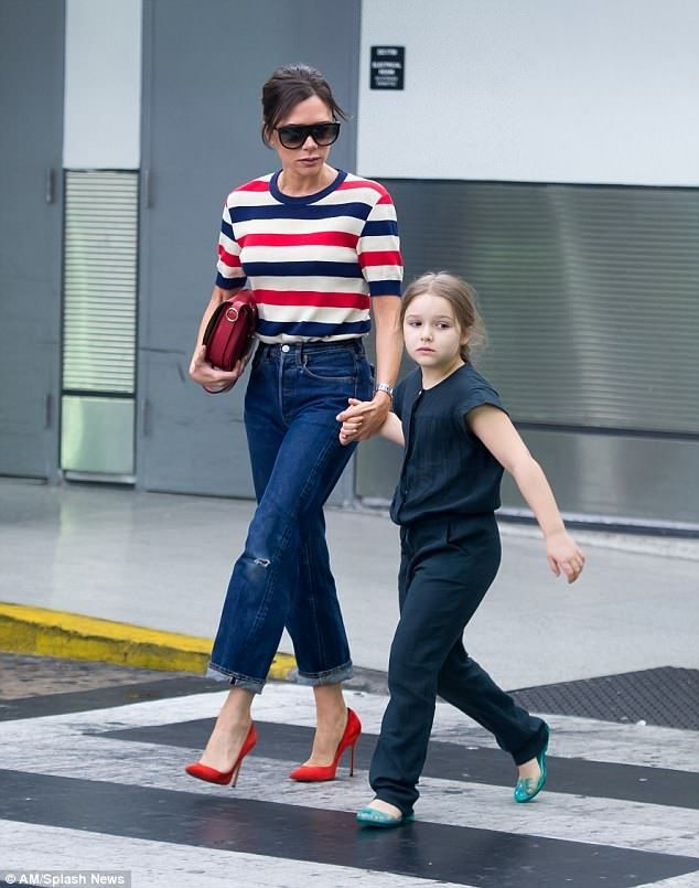 ef8f49e1e4f Victoria Beckham kisses tired daughter Harper as they arrive in US ...