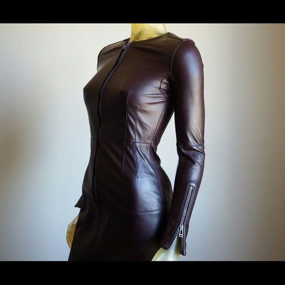"""Belstaff Wigston Burgundy Leather Sheath Dress Belstaff black-label leather dress.  Smooth, buttery soft, leather crewneck long-sleeve dress with zipper front and cuffs. Beautiful (hard to find) Burgundy color. Epaulettes and under-arm ventilation grommets.  Belstaff is a global luxury lifestyle brand steeped in its unique British heritage and the spirit of adventure. A celebrity favored brand.  43"""" long from backseam to hem. Dress has slight repair at back kick pleat, not noticeable when…"""