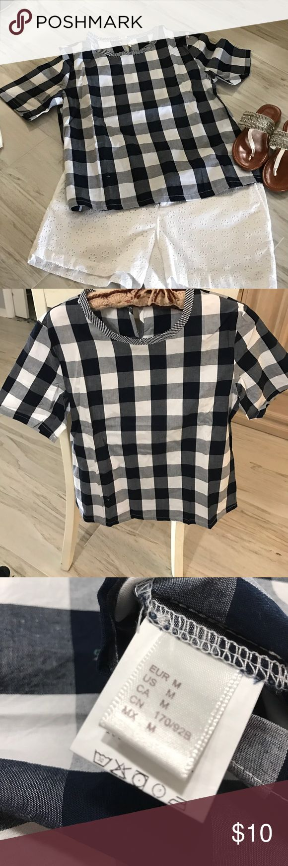 NWOT blue and white checked Blue and white checked top. Size medium. Never worn Tops