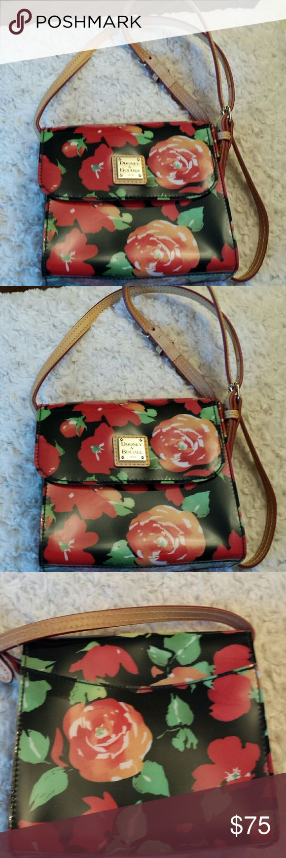 Dooney and Bourke Red Rose Garden Letter Bag RARE Dooney and Bourke Red Rose Garden Letter Carrier Mini  Crossbody Bag, Leather Strap with PVC Material, Slip pocket inside, zip pocket inside, Snap closure, Good condition, Dooney label inside can't get a great pic due to the angle, These bags do not come with a charm/fob Dooney and Bourke  Bags Crossbody Bags