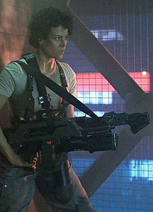 Aliens - 1986. Sequel to 1979's Alien. Sigourney Weaver, as sole survivor Ripley, and I think the first tough, take charge and rescue herself female protagonist in a scifi/horror movie. Maybe any movie genre to that point?