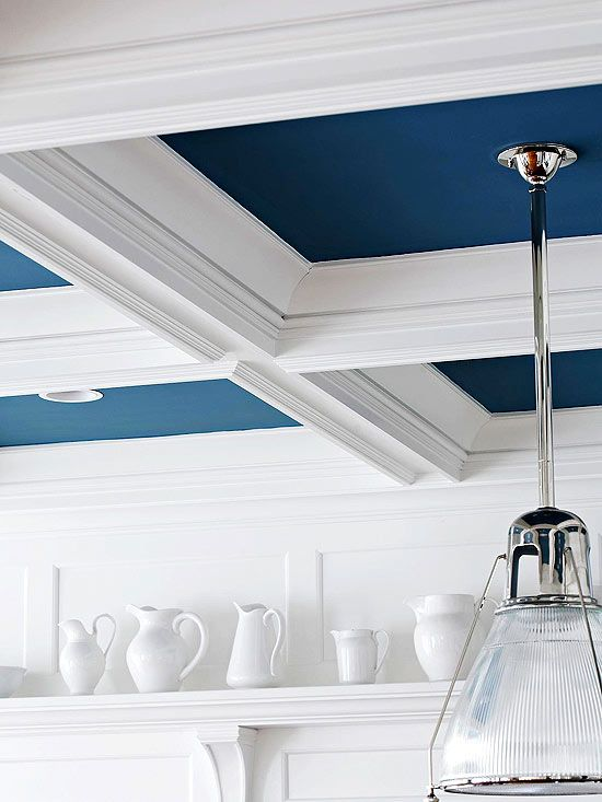 Bright pop on the ceiling. BHG says: Give your ceiling a little eye candy. Beautifully highlight a coffered ceiling with colorful paint, and keep the trim white for a bold visual effect. Placing a ceiling medallion around a fan or light fixture is another way to add architectural flair overhead. Decorative ceiling medallions are available in all shapes, sizes, and styles