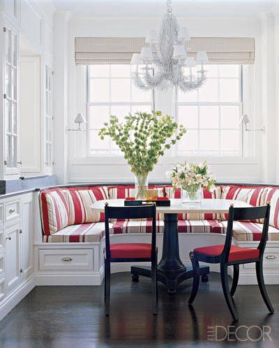 A vibrant red-and-white-stripe cotton enlivens a sunny breakfast nook