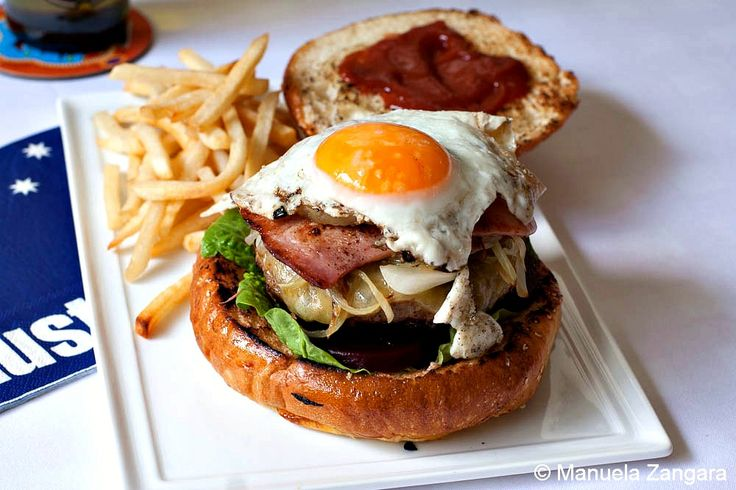 "Aussie burger with ""the lot""... cheese burger with lettuce, tomato, beef patty, cheese, ketchup, beetroot (sliced pickled beets), fried onions, bacon, pineapple AND a fried egg on the top"