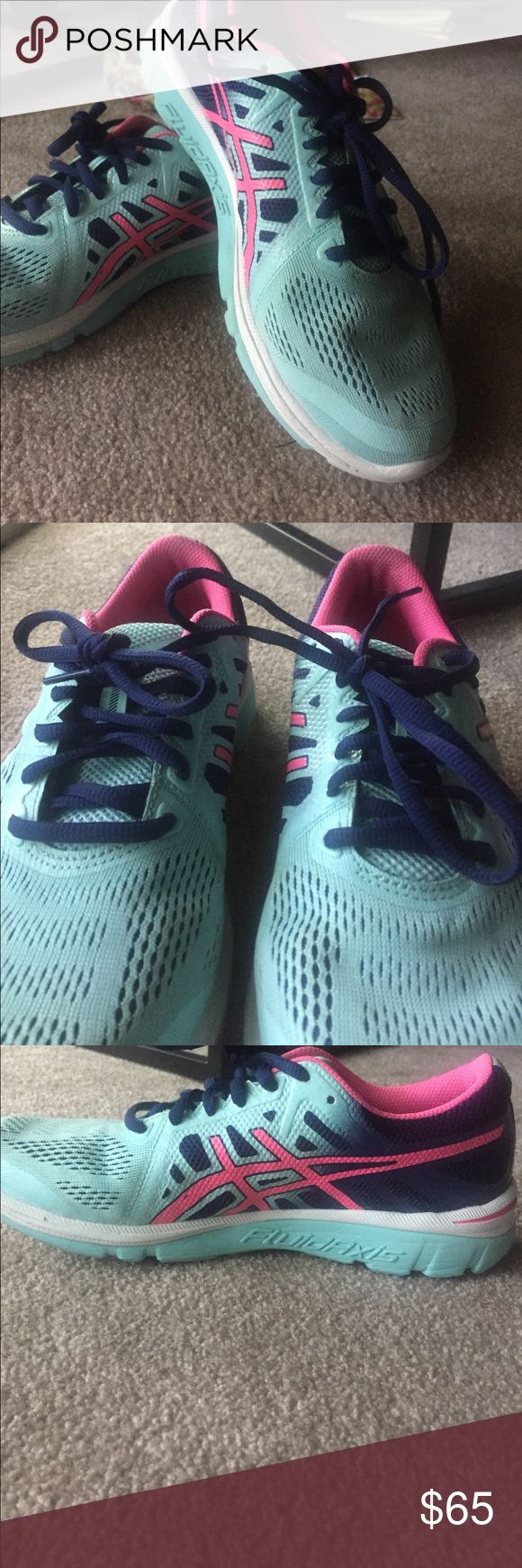 Size 7 Asics Fluid Axis cross training shoe! Asics fluid axis light blue, navy, and pink cross training shoe. Lightly worn but in great shape. Offers welcome! Asics Shoes Athletic Shoes