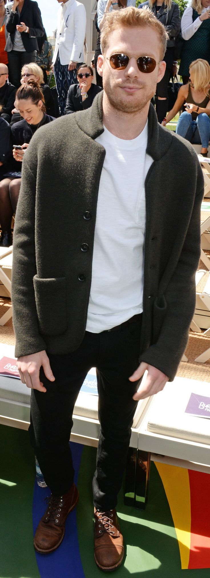 Australian actor Sam Reid wearing a knitted Burberry cashmere tailored jacket to attend the Burberry show in Kensington Gardens