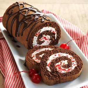 The cake roll's luscious filling is made with light cream cheese, light whipped topping, and maraschino cherries.