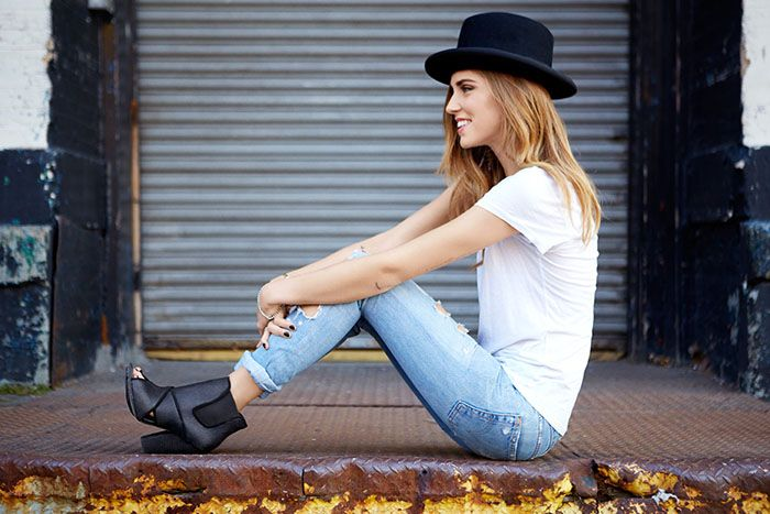 Shop this look for $67:  http://lookastic.com/women/looks/black-hat-and-white-crew-neck-t-shirt-and-light-blue-skinny-jeans-and-black-chelsea-boots/1145  — Black Hat  — White Crew-neck T-shirt  — Light Blue Skinny Jeans  — Black Chelsea Boots
