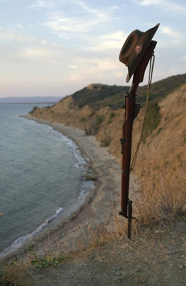 Anzac legend ... A 303 Lee Enfield rifle and slouch hat on the shore at Anzac Cove, Galli